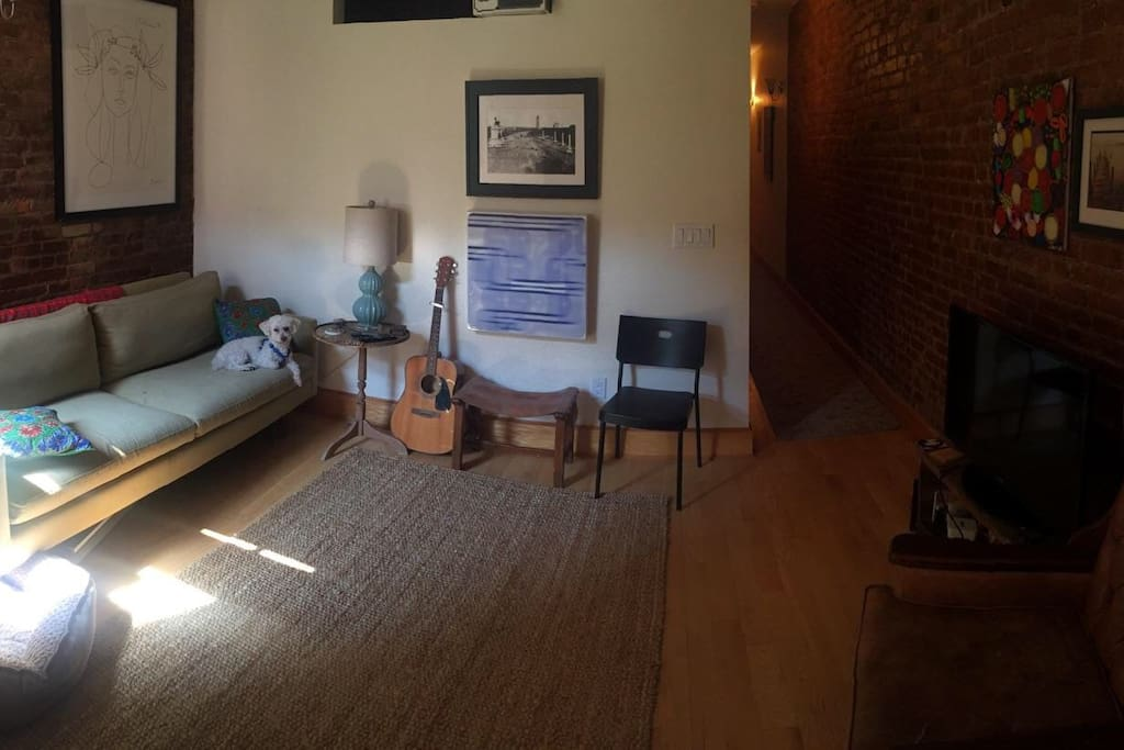 Living room!  Strum the guitar!