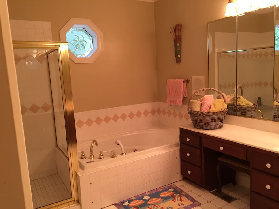 Large private bath with whirlpool tub.