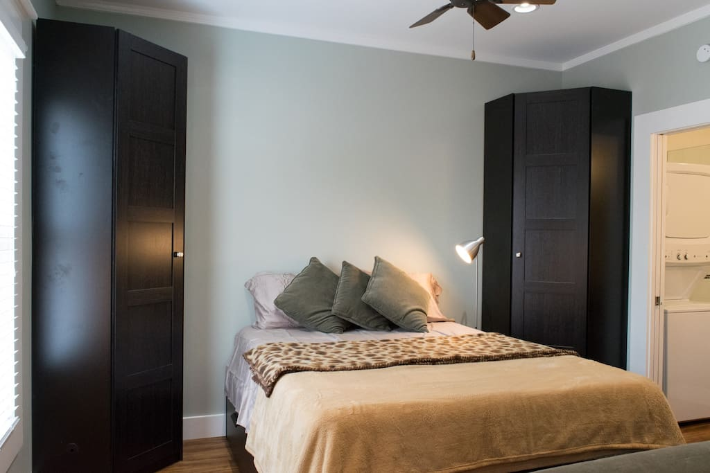 Comfortable queen size bed and two closets