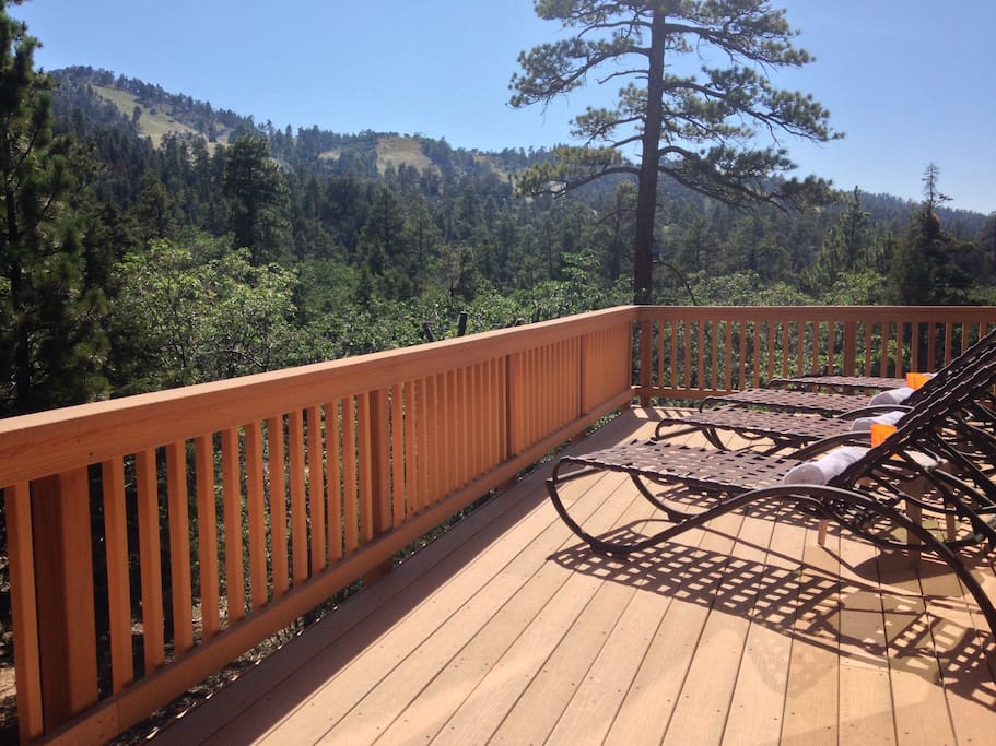 Expansive deck allows for sunbathing and gazing at the mountains from 4 loungers in Spring & Summer