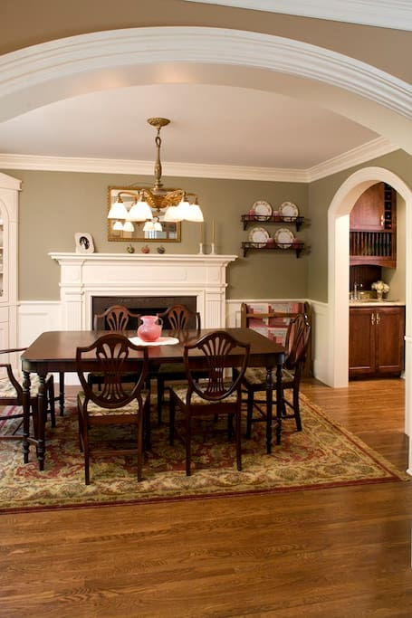 Dining with gas fireplace, built-ins and antique furniture, wainscoating