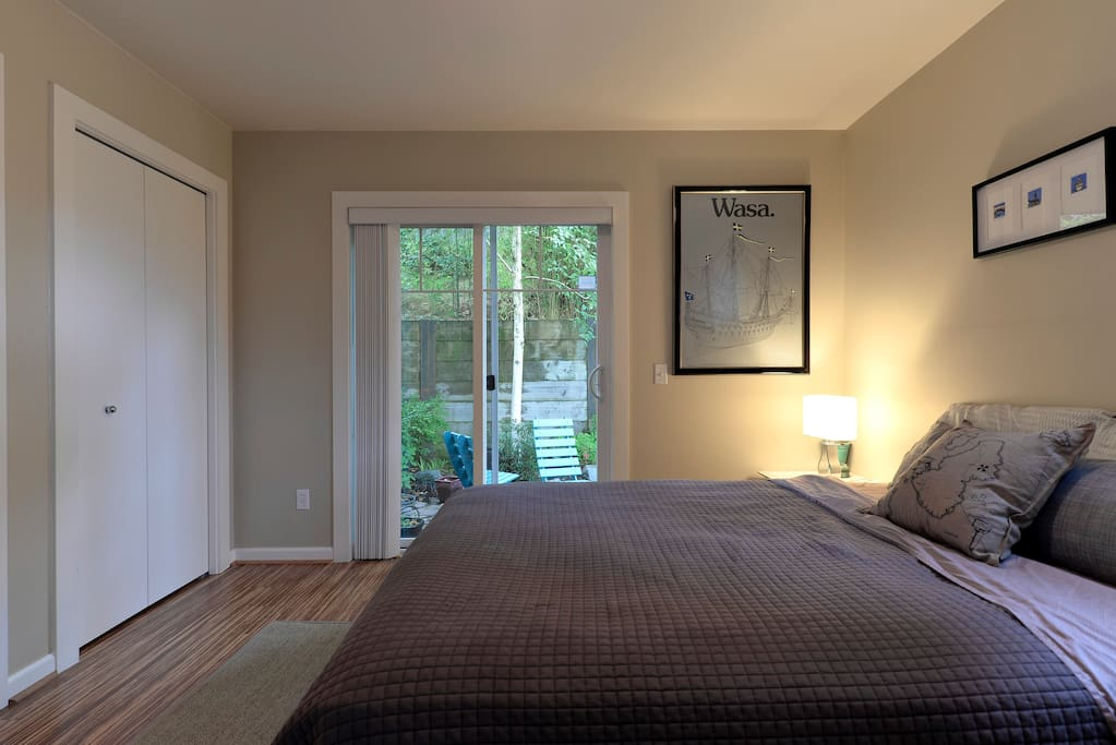 The guest bedroom looks out to a  relaxing private garden.