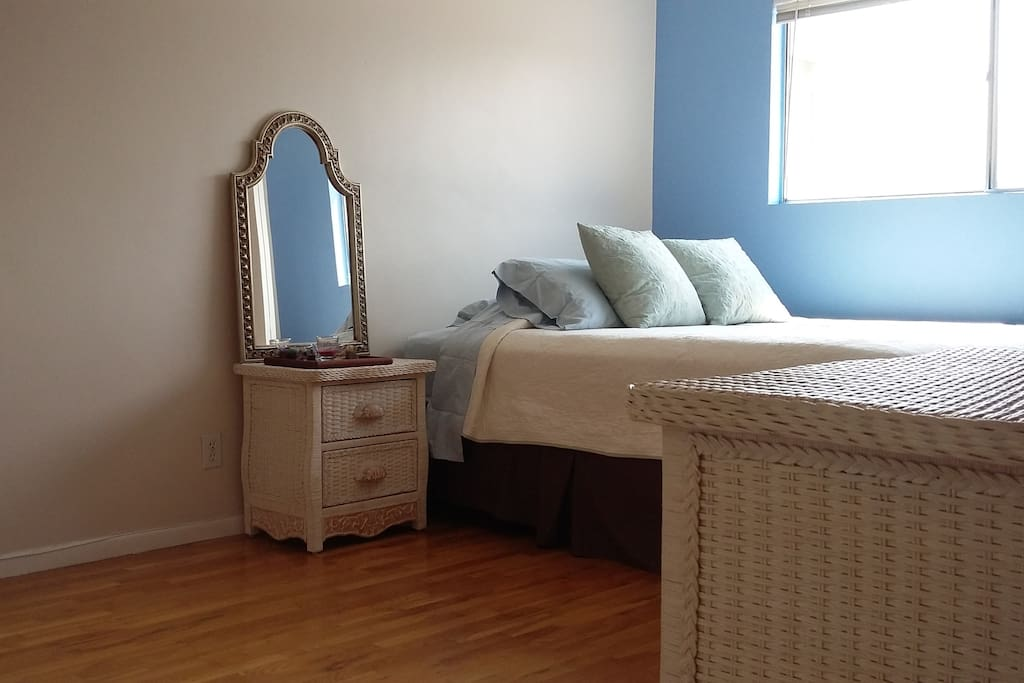 Bedroom includes Queen size bed, Armoire, dresser, night stand, closet space. Wood floors, new 500 count Egyptian Cotton sheets, new blanket, new mattress..
