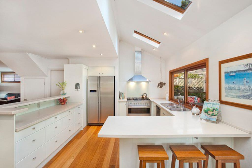 Large open kitchen with lots of natural light and quality appliances.
