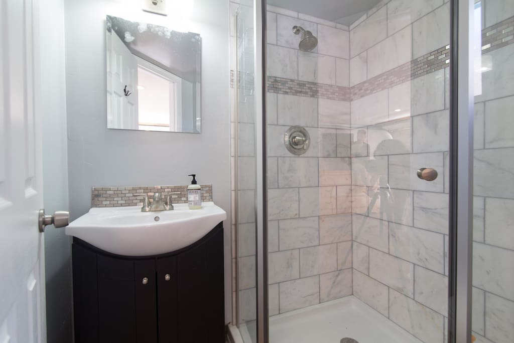 Brand new bathroom installed with marble tile