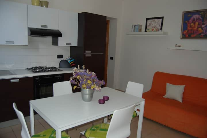 Modern flat with parking, garden and BBQ