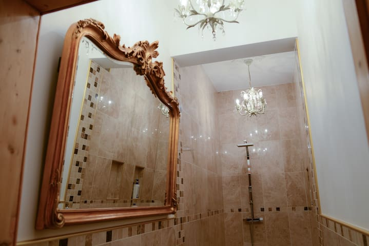 Close-up of the beautiful original Laura Ashley mirror in the bathroom