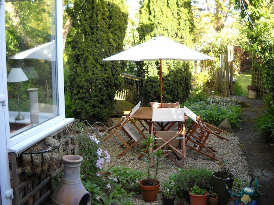Conservatory at rear of house and garden/pond
