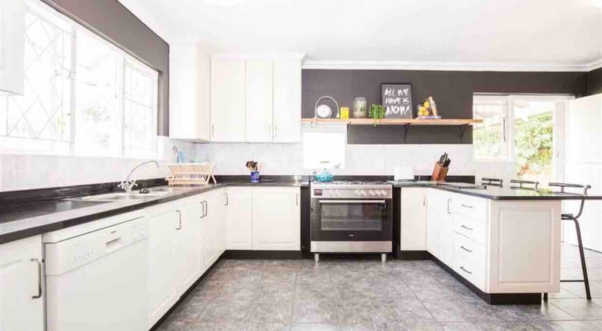 Kitchen equipped with gas hob and electric oven, dishwasher, microwave, kettle, toaster and fridge. Leads out to patio and garden.