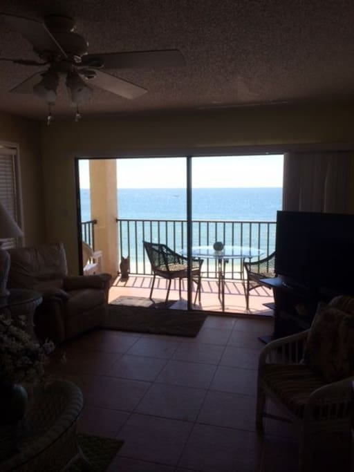 Living room with balcony and gulf views
