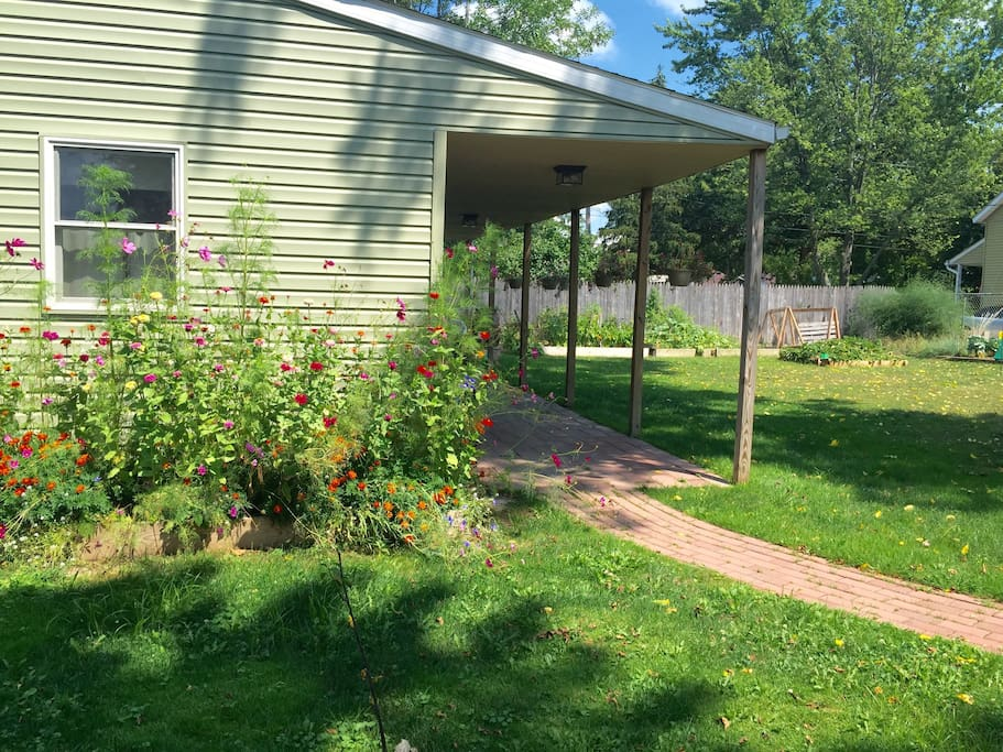Side yard with view of flower and vegetable gardens