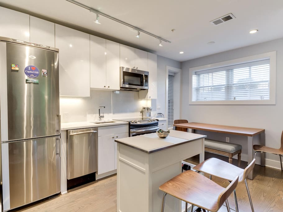 Modern European style kitchen w/stainless steel appliances. Kitchenware provided.