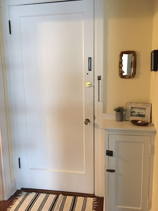 Front entry door/ hall. Bathroom off to the left.
