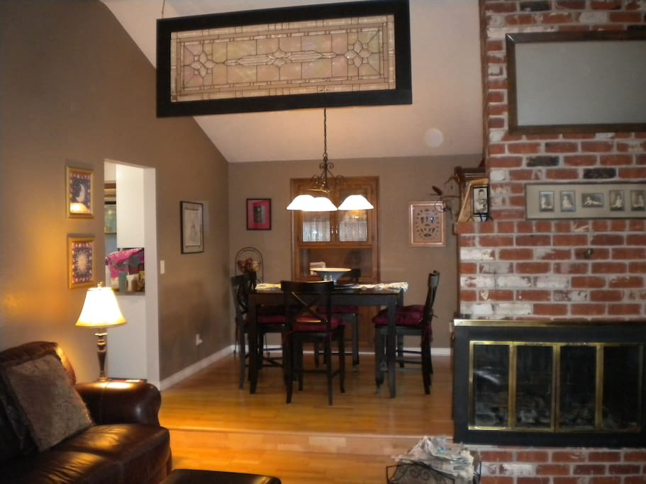The living/dining room includes a wood burning fireplace.