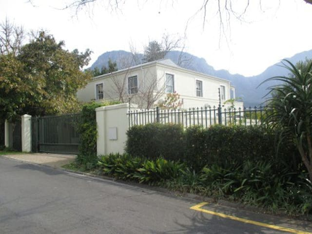 Side of house with Table Mountain in background