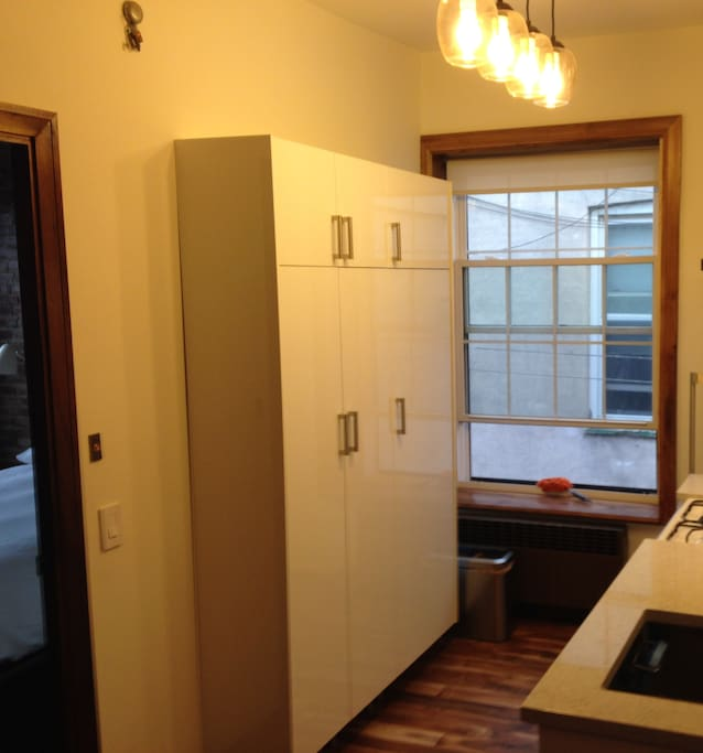Pantry - Large Window with Wood Frame, Acacia Hardwood Floors Throughout.