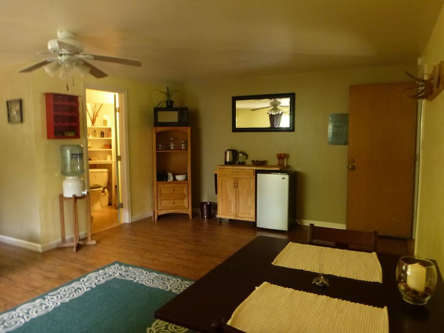 The kitchenette, entry, sitting area and bathroom.