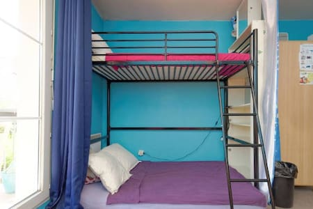 Below Bunk Bed with balcony