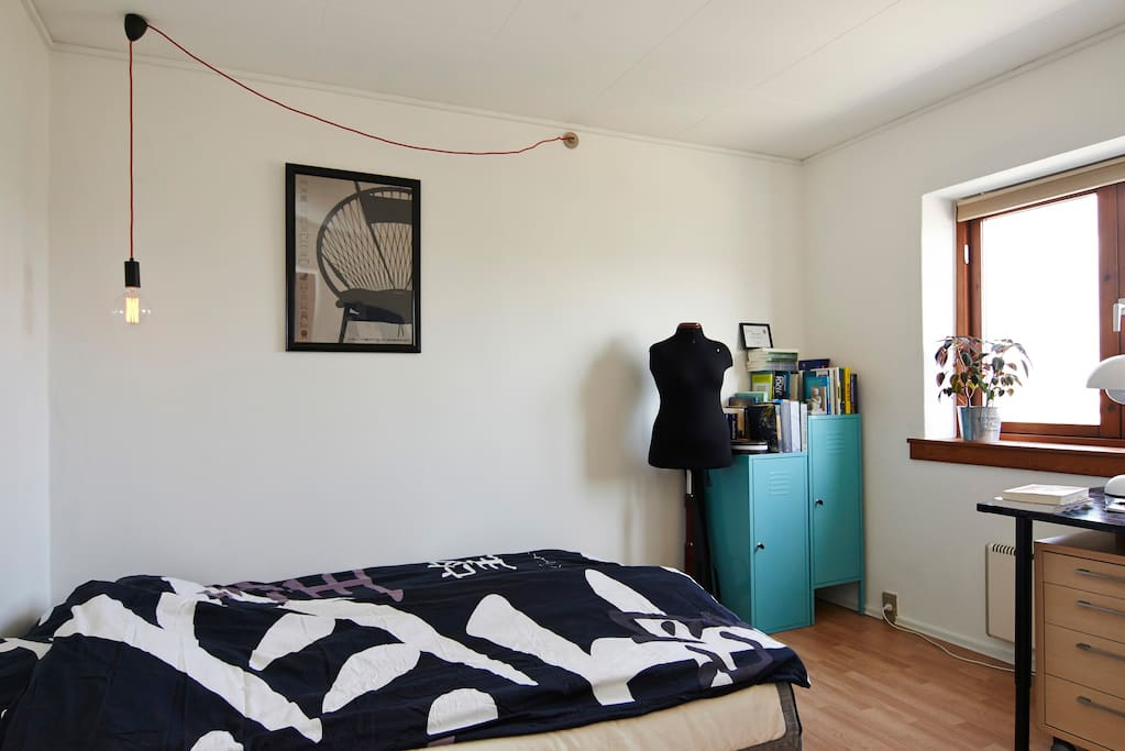 The room seen from the kitchendoor with the sofabed folded out as an bed