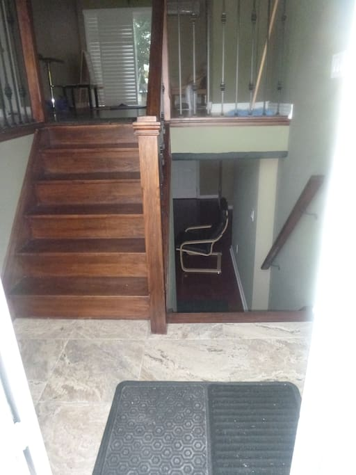 Upon entry, you'll see the stairs going to the ground floor, stairs going to the finished basement