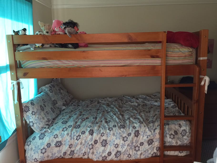 Upstairs bedroom with fullsized bunk bed, memory foam topper