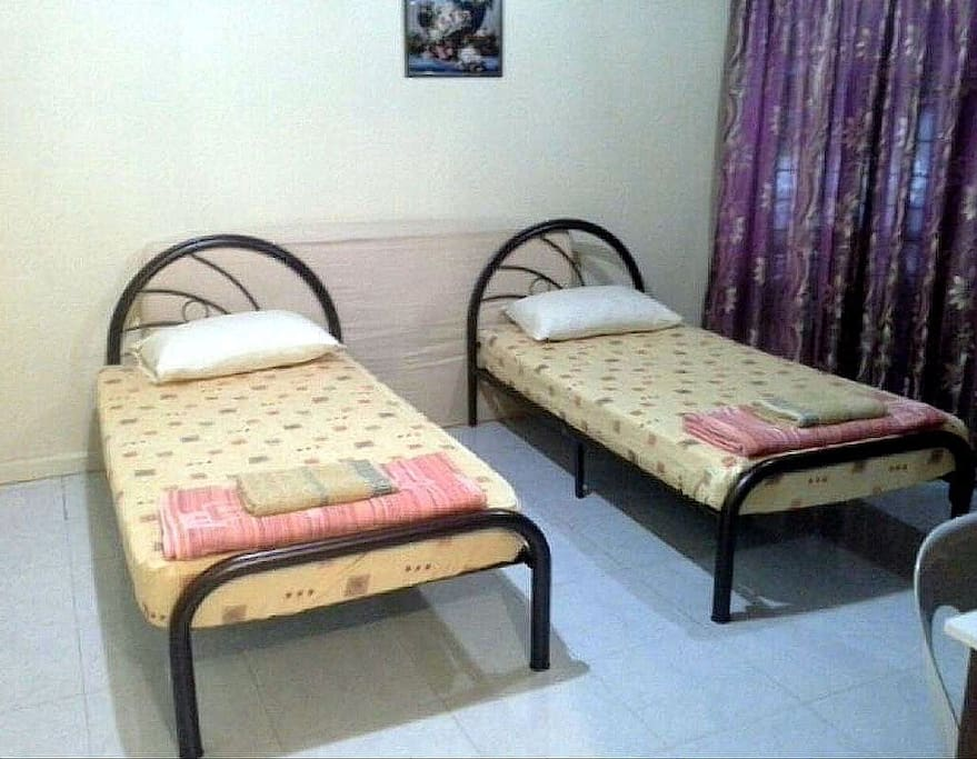 room C with 2 single beds