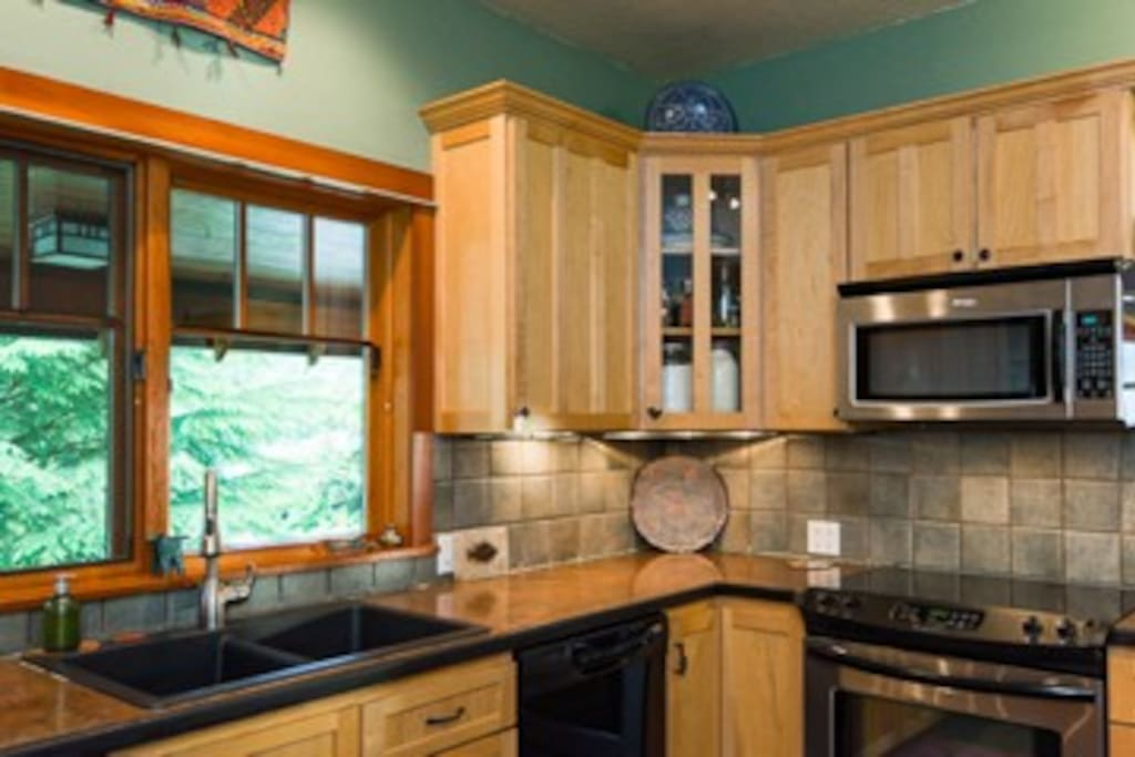 Kitchen with maple cabinets and stainless appliances