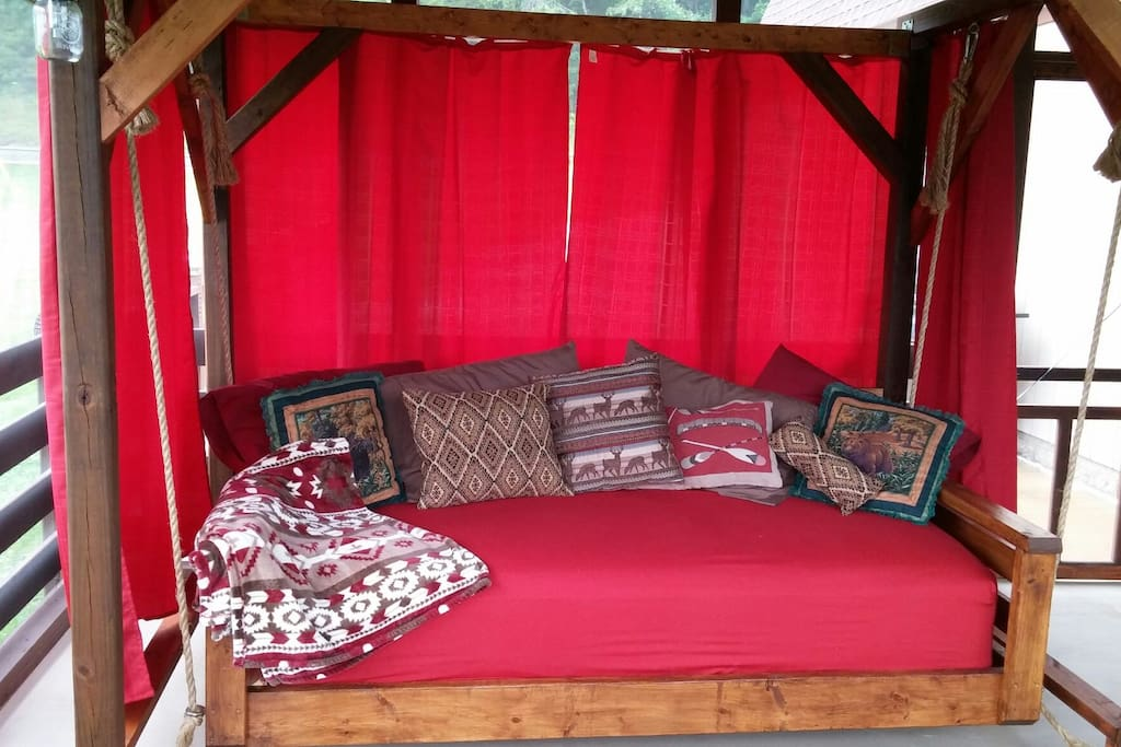Custom swinging bed on screen porch (summertime)
