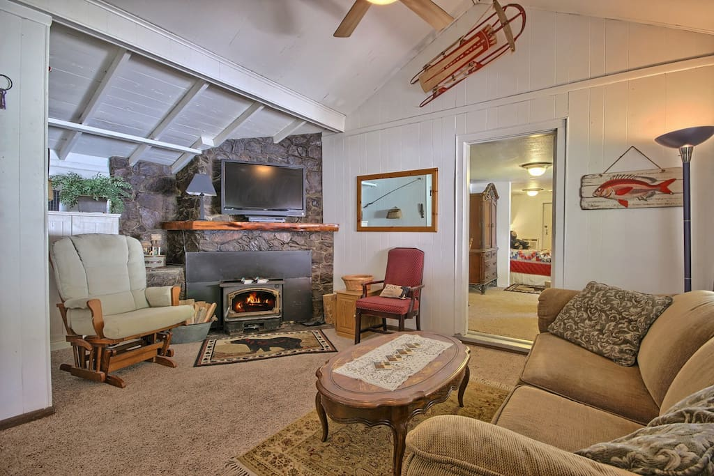 Living room has a cozy fireplace with complimentary firewood.