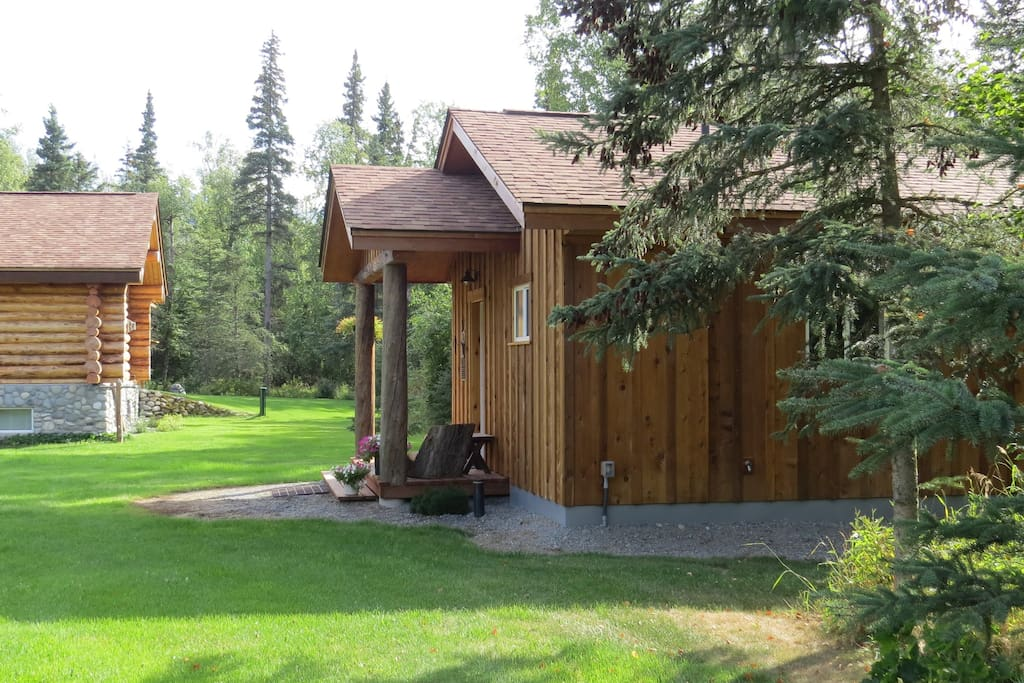 The cabin is located near the main house, with no other neighbors in sight.