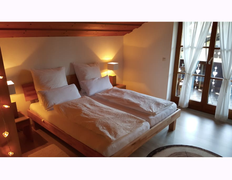 King size bed in this Lovely Bavarian Nest with access to the large balcony