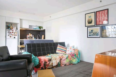 Sofabed in bright CBD apartment