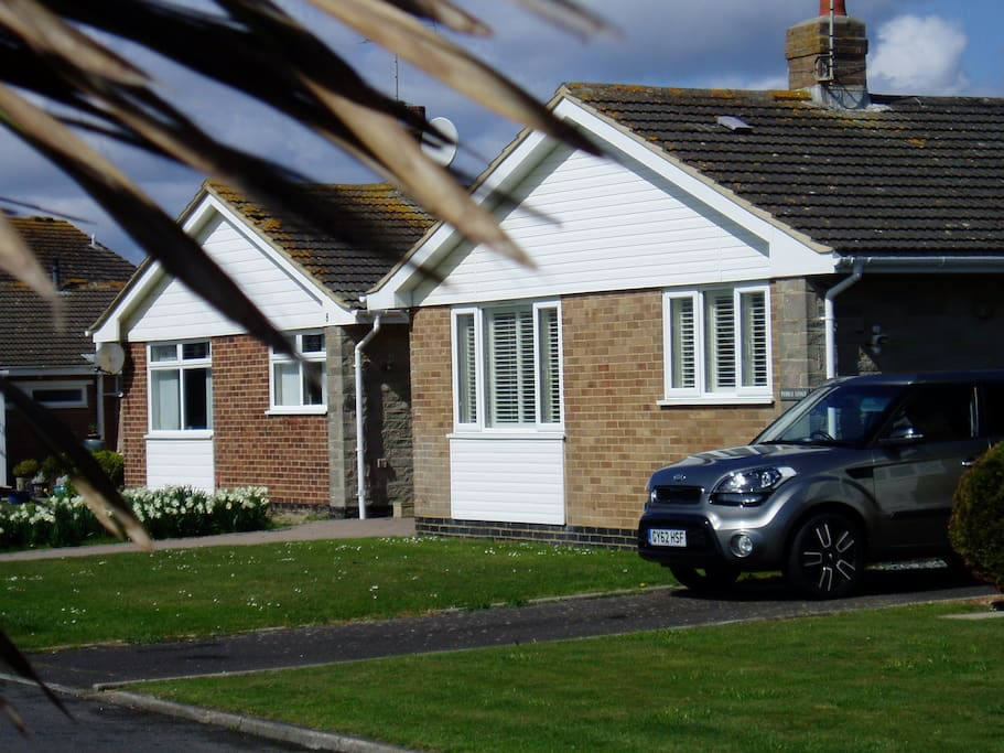 Detached bungalow on private road with off street parking for 2-3 cars