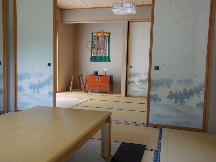 The guest rooms on the 1st Floor with sliding doors to separate the sleeping and sitting areas.  /  1階にあるゲストルームは二間続きの和室
