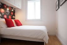 Main bedroom with double bed and view of St. Patrick's Cathedral