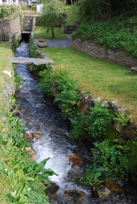 The stream running through the garden (there's a barbecue area)