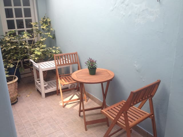 At the back of the house there is an open area with table and chairs to enjoy breakfast