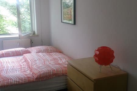 You have your own private room with 10 m² in 2 bed apartment . You can use the living room and of course bath and kitchen. Close to the harbour, train or bus stop. 5 min. walk to restaurants, supermarket. Parking is available at the street.