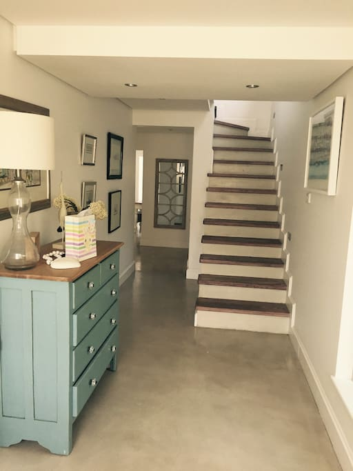 entrance, staircase to four bedrooms upstairs.