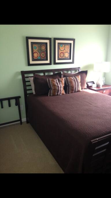 Fully furnished guest room with queen bed