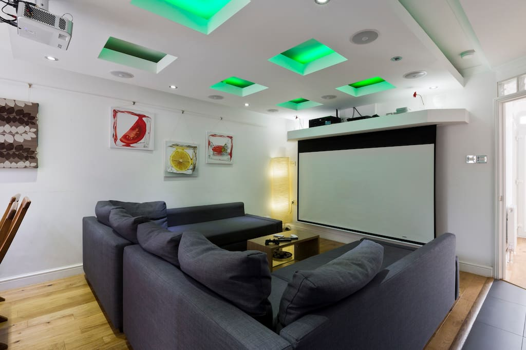 Reception Room - Enjoy a movie on the built-in remote control projection screen, complete with surround-sound system