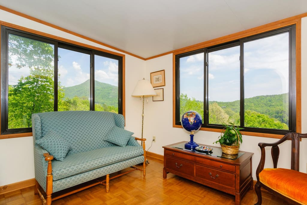 Reading room with view of mountains and lake