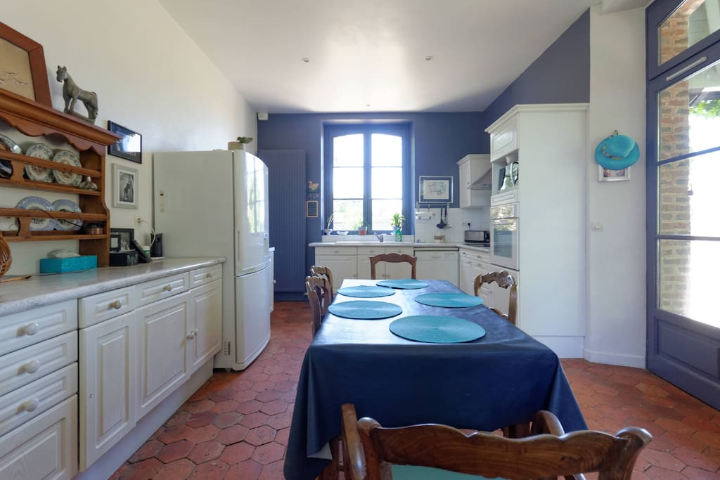 The kitchen opens directly onto the garden