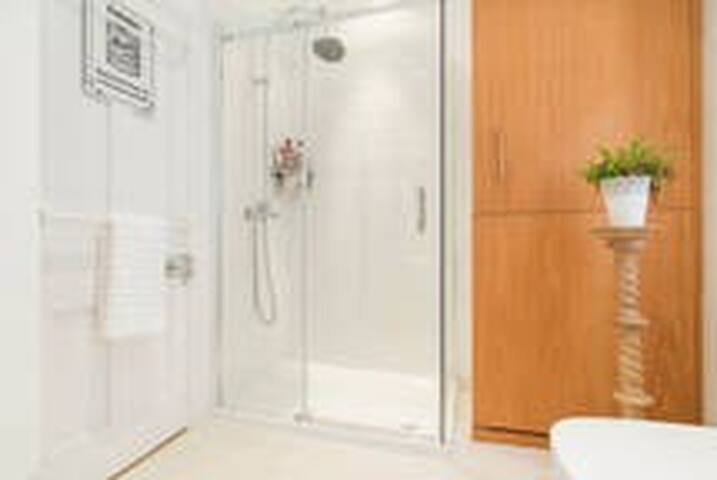 Bathroom with large shower and freestanding bath
