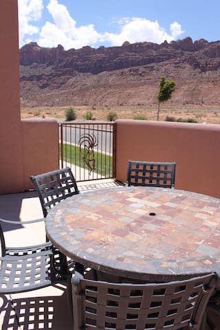Patio in summer, corner unit with unobstructed rim views in one direction, La Sal Mountains the other.