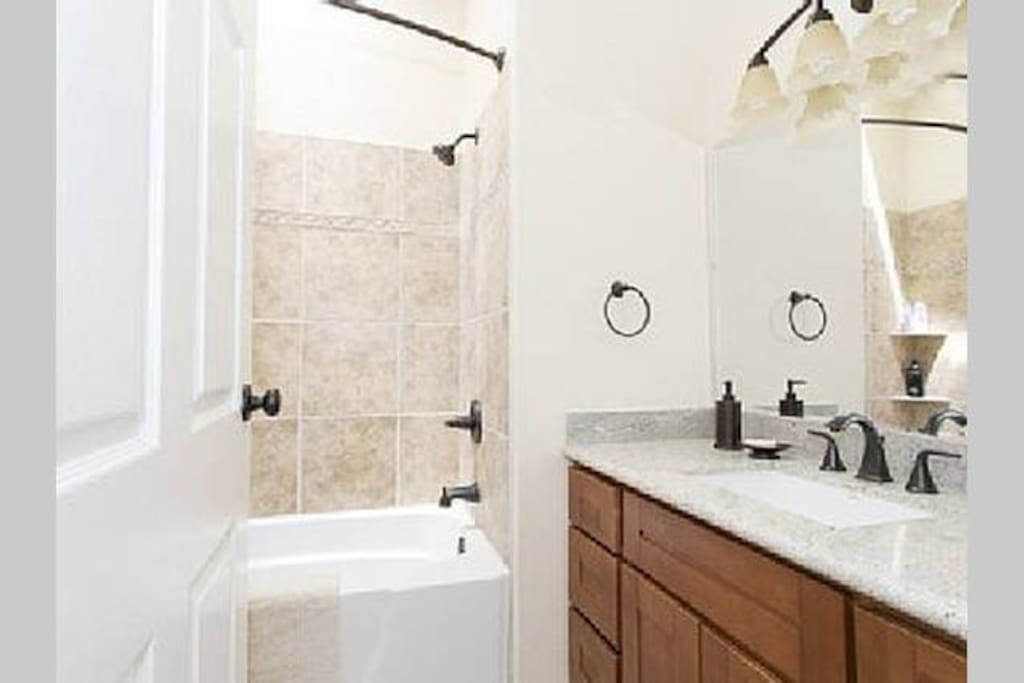 Private clean full bathroom with shower and bathtub