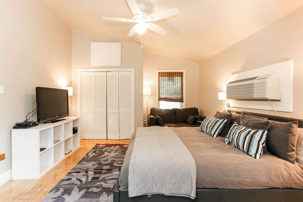 California King Bed with pillow-top mattress and luxury linens.