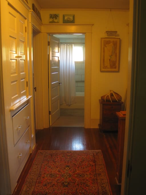 Shared hallway faces west to the bathroom entrance.
