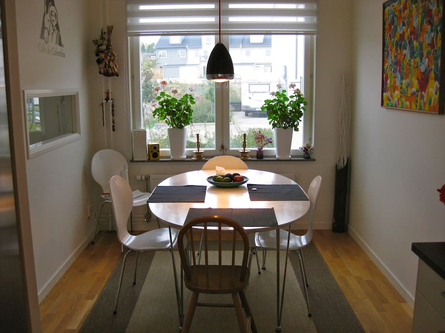 Diningroom is next to the kitchen. There is an extra piece to the table, with space for dinners, up to 10 persons.