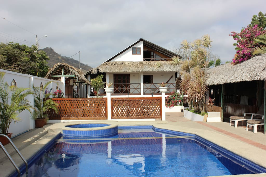 Two bedroom guest house and sitting room, overlooking pool and gardens